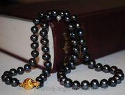 Ожерелье из черного морского жемчуга.