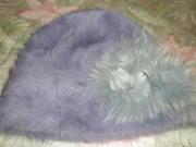 Продам новую, женскую шапку-ангорку, с цветком-украшением, серо-голубая.