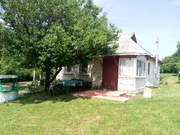 Дом в  центре села Медвин. 140 км